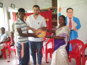 Planete Urgence Volunteer Anthony Personeni recieving a gift from his kootukural computer training students & Lalidamballe from ADECOM